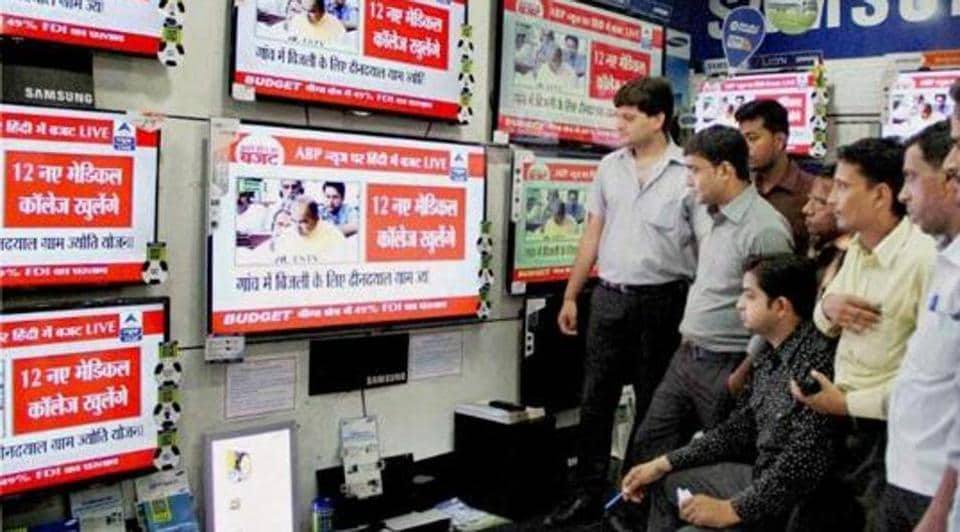 People in Allahabad watch a live telecast on TV. (PTI photo / Representative Image)