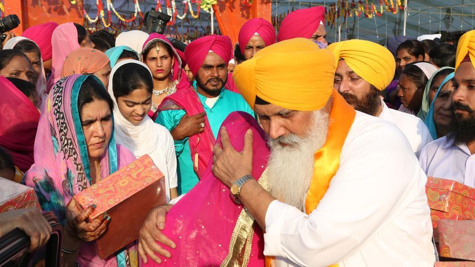 Match-maker: Bhai Balwinder Singh Rangila blesses a girl at mass marriage ceremony; (right) at his house in Sector 40, Chandigarh.