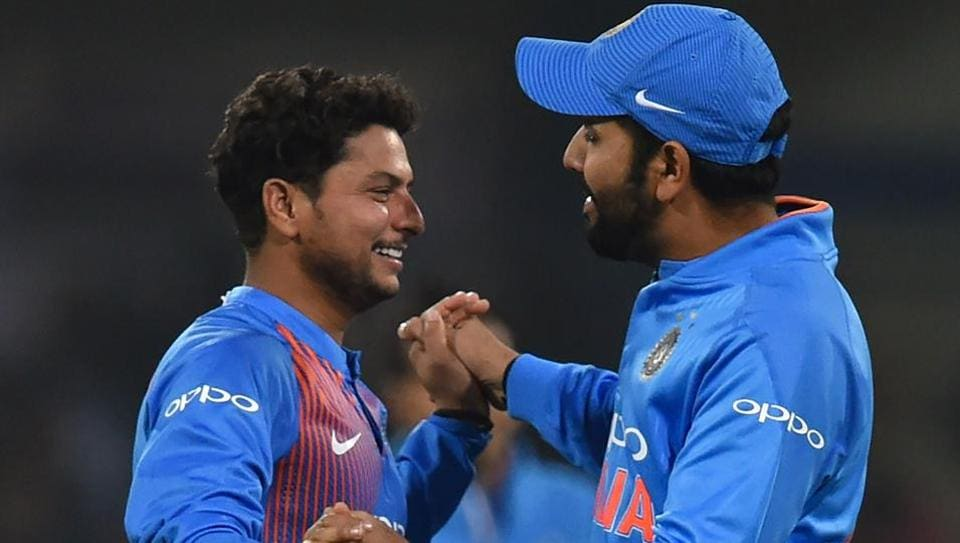 Indian cricketer Kuldeep Yadav (L) celebrates with captain Rohit Sharma after taking the wicket of Kusal Perera during the second T20 international between India and Sri Lanka at the Holkar Stadium in Indore on December 22. Sharma said he was confident in both Yadav and Yuzvendra Chahal despite the spinners leaking runs early in the game.