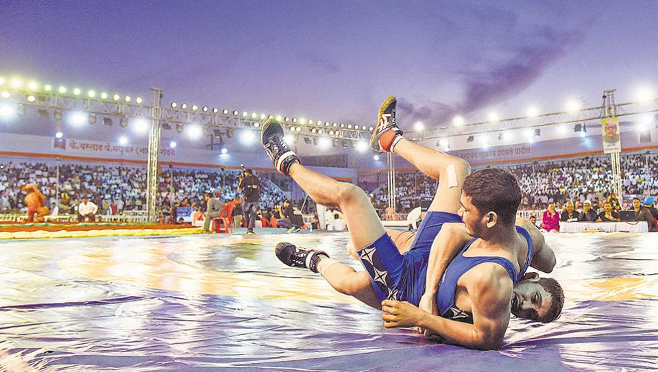 Wrestlers battle it out at the 61st Senior State Wrestling Competition in Bhugaon. In the 61st Senior State Wrestling Competition, Pune's Nilesh Kedar defeated Nashik's Sonu Bagul in the second round.