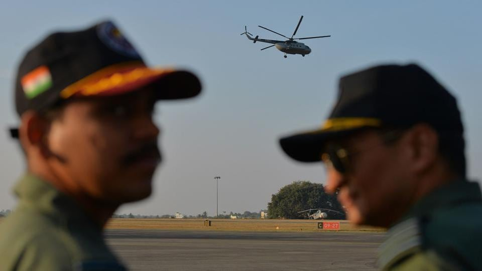 Indian Airforce (IAF) MI-8 Helicopter, also known as 'PRATAP' makes final flight during the phasing out ceremony held to bid adieu to the Russian made multi-role chopper at the Yelahanka Airforce Station in Bangalore on Sunday. (Manjunath Kiran  / AFP)