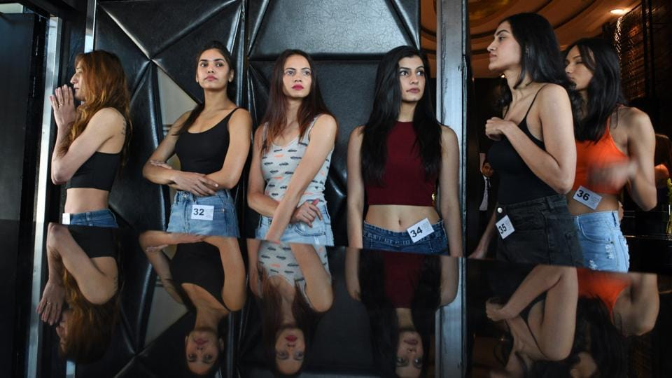 Models wait to appear before judges during the Lakme Fashion Week model auditions at The St. Regis in Mumbai on Wednesday. (Satyabrata Tripathy / HT Photo)