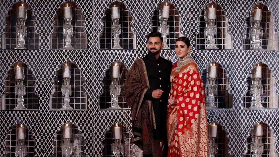 India's cricket team captain Virat Kohli (L) and his wife, Bollywood actress Anushka Sharma, pose during a photo-op at their wedding reception in New Delhi on Thursday. (Adnan Abidi  / REUTERS)