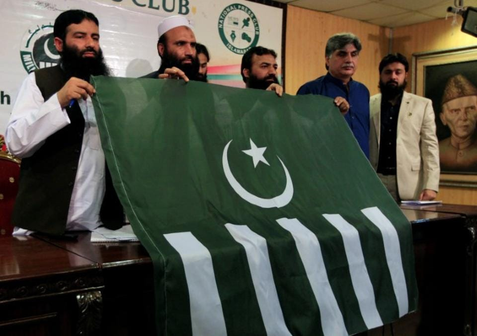 File photo of Milli Muslim League president Saifullah Khalid (second from left) at a news conference in Islamabad.