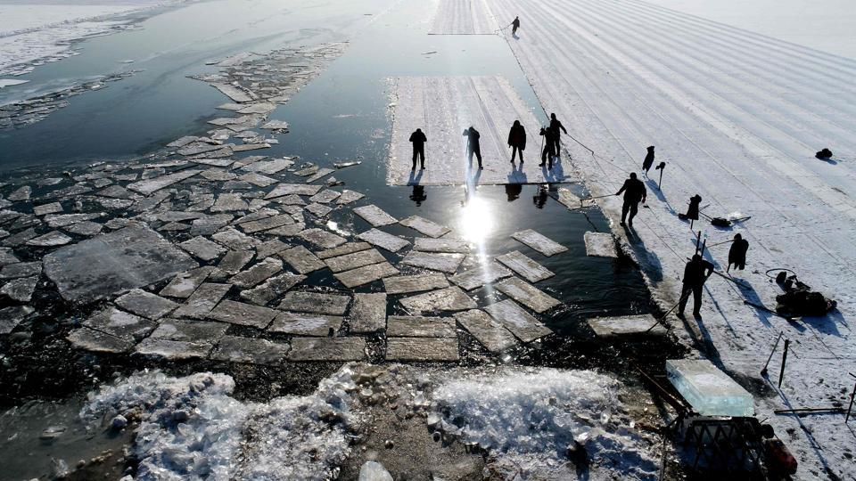 An aerial view shows floating ice blocks cut from the frozen surface of Xiuhu lake in Shenyang, China on December 20, 2017. The ice blocks are used as part of winter tourism activities in the region. (AFP)