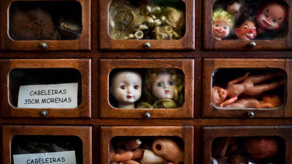 Drawers full of doll parts, a macabre collection of heads, limbs and eyes make up the doll surgeons' repository at the hospital in Lisbon. It gives care to 100-year-old dolls with porcelain heads, along with dolls dressed in costumes from different regions of Portugal, as well as some modern Barbies. (Patricia De Melo Moreira / AFP)
