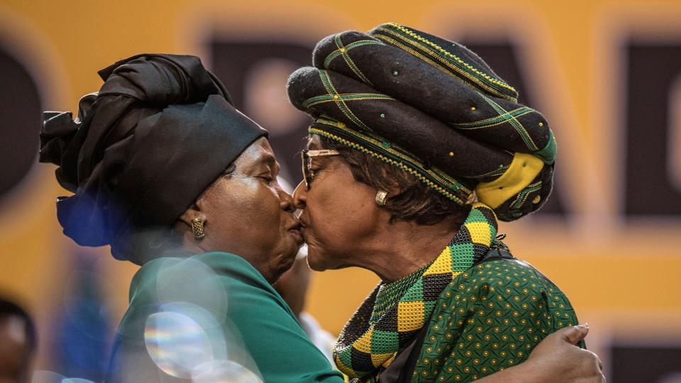 The former wife of Nelson Mandela, Winnie Mandela (R), and candidate for the African National Congress presidency and ex-wife of incumbent South African president, Nkosazana Dlamini-Zuma greet each other as they attend the 54th ANC National Conference at the NASREC Expo Centre in Johannesburg on December 16, 2017.  (Mujahid Safodien / AFP)