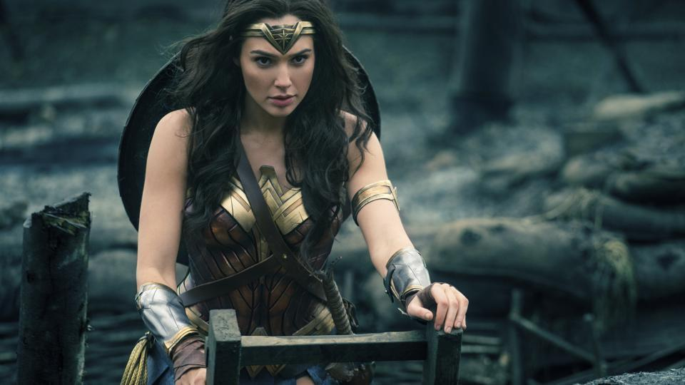 This image released by Warner Bros. Entertainment shows Gal Gadot emerging from a trench during a WWI battle scene in Wonder Woman.