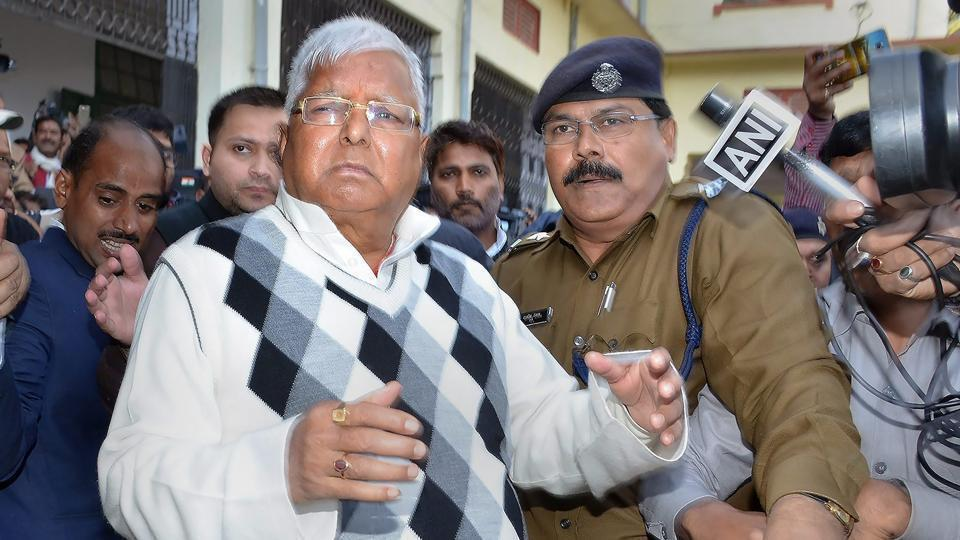RJD supremo Lalu Prasad Yadav escorted by police officials after being convicted by a special CBI court in a fodder scam case, in Ranchi on Saturday.