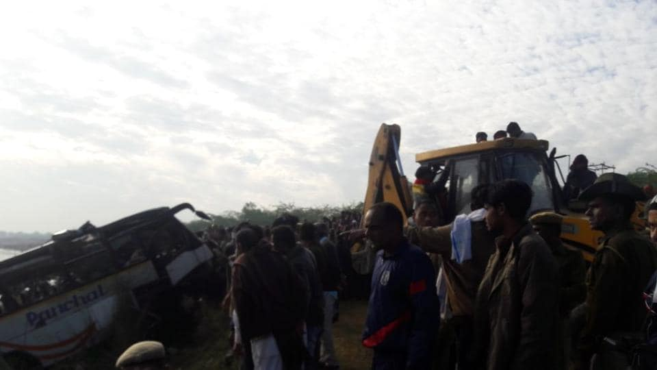 Dozens killed as bus plunges 65ft into river in western India