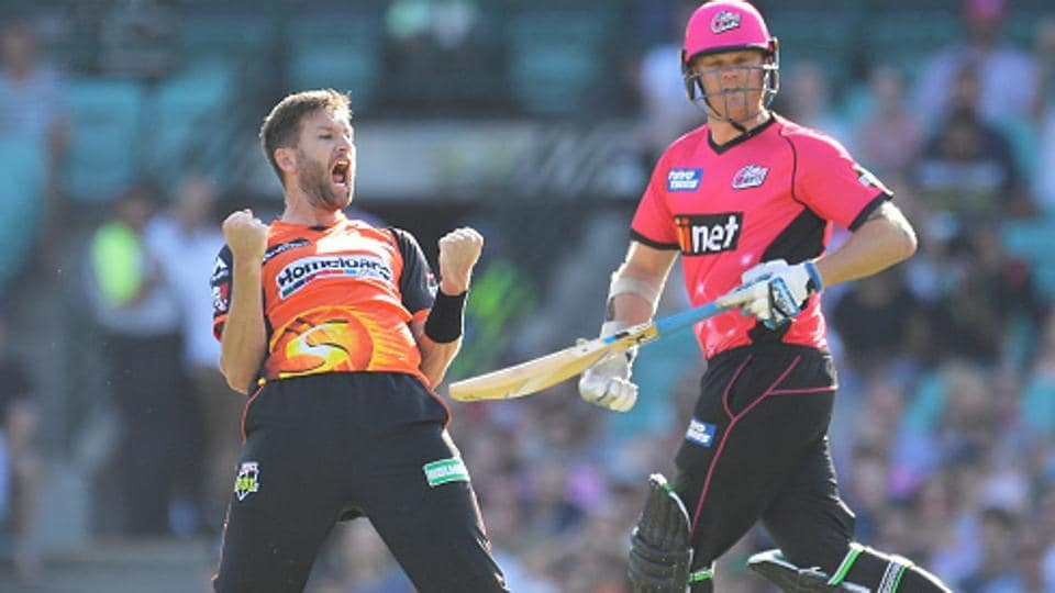 Andrew Tye (L) of Perth Scorchers celebrates his hat-trick after dismissing Daniel Sams of Sydney Sixers during their Big Bash League match in Sydney.