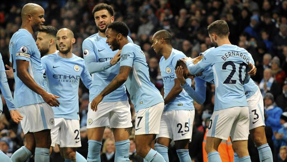 Manchester City's Danilo, second right, celebrates with teammates after scoring his side's fourth goal during the English Premier League match between Manchester City and Bournemouth at Etihad Stadium, in Manchester, England on Saturday.