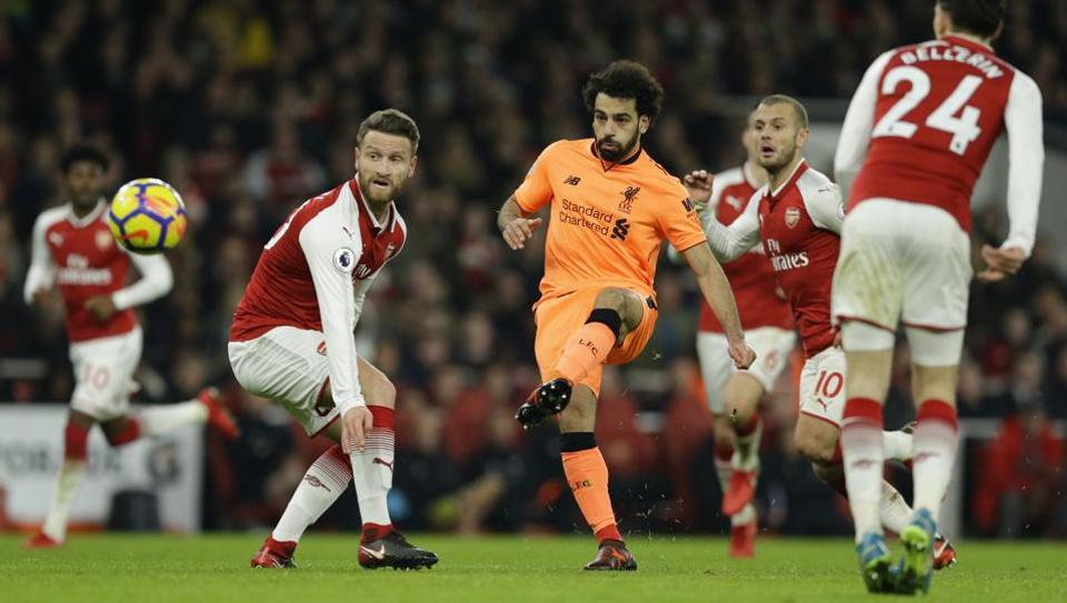 Liverpool's Mohamed Salah shoots and scores during his side's Premier League match against Arsenal.