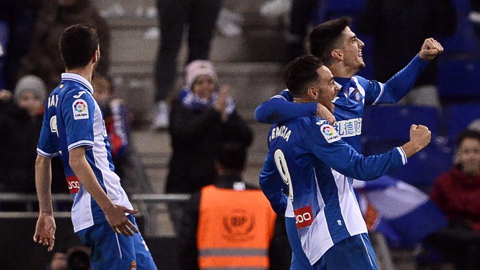 Espanyol's Spanish forward Sergio García (2R) celebrates his winner during the La Liga against Club Atletico de Madrid atthe RCDE Stadium in Cornella de Llobregat on Friday.
