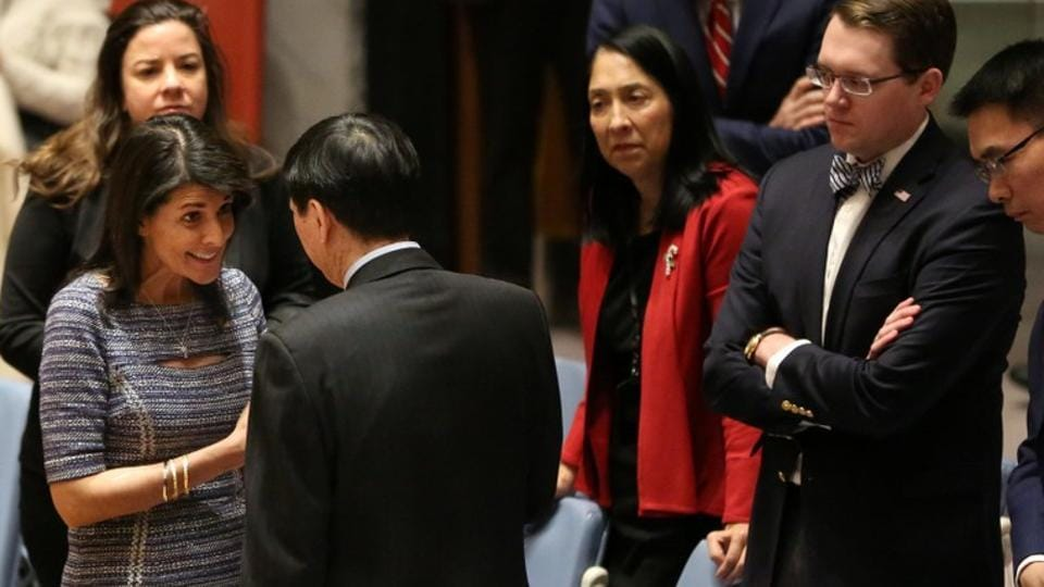 US Ambassador to the United Nations Nikki Haley speaks with Chinese Deputy Ambassador to the United Nations Wu Haitao ahead of the United Nations Security Council session on imposing new sanctions on North Korea in New York on December 22