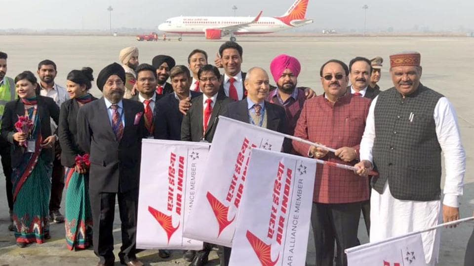 Vijay Sampla (R), Rajya Sabha MP Shwait Malik with Air India staff members during the flagging off of the Amritsar-Nanded flight from Sri Guru Ram Das Jee International Airport in Amritsar on Saturday.