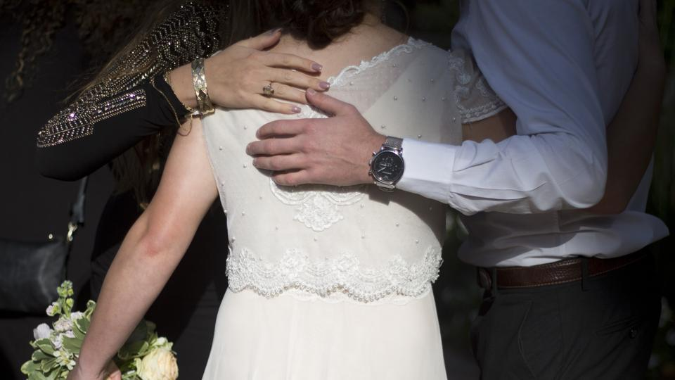 A bride hugs her friends during her wedding in Ein Hemed. A growing number of Israeli couples are defying the country's Chief Rabbinate and marrying in unsanctioned weddings.