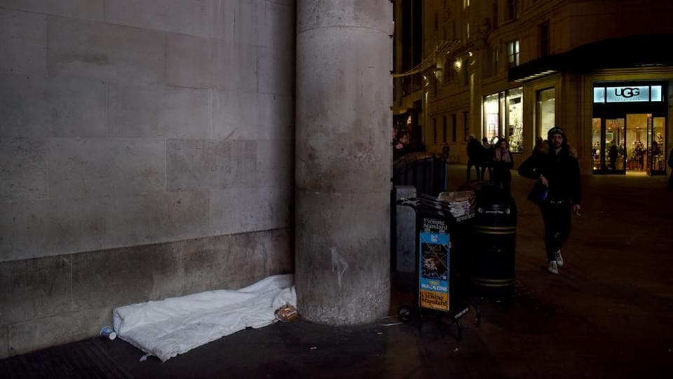 A loaf of bread is placed alongside bedding belonging to Jason, aged 41 at the entrance to Piccadilly Station. The government has set a target of halving rough-sleeping by 2022 and abolishing it by 2027. Last week, Prime Minister Theresa May told lawmakers the government would spend 500 million pounds on tackling homelessness and was putting in projects to tackle rough-sleeping. (Mary Turner / REUTERS)