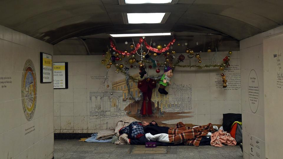 Homeless Kel sleeps in the subway next to Hyde Park Station in London. The charity Shelter estimates more than 300,000 people in Britain are homeless, a figure which has risen by 13,000 in a year. It says one in every 200 people in England is homeless and 128,000 children will be without a home this Christmas. (Mary Turner / REUTERS)