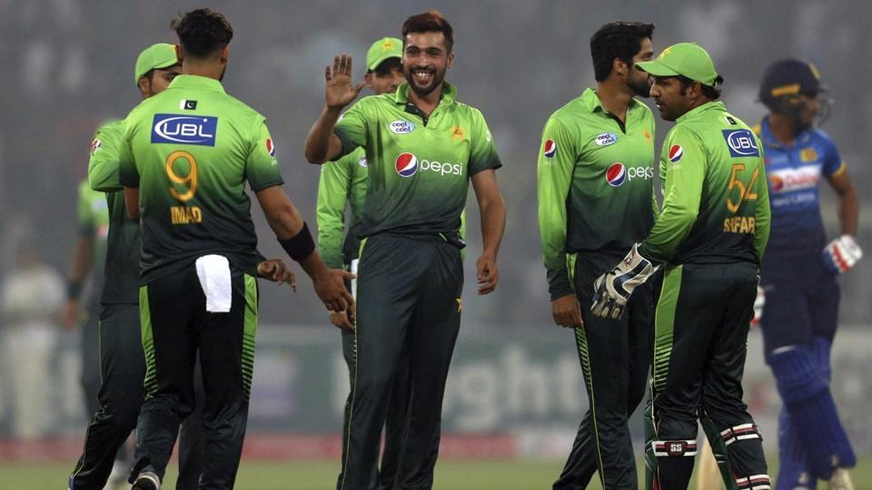 Pakistan's Mohammad Amir, center, celebrates with teammates after taking the wicket of Sri Lankan batsman Dilshan Munaweera during their third Twenty20 international match at the Gaddafi stadium in Lahore on  Oct. 29, 2017. Amir has been picked for the tour in New Zealand.