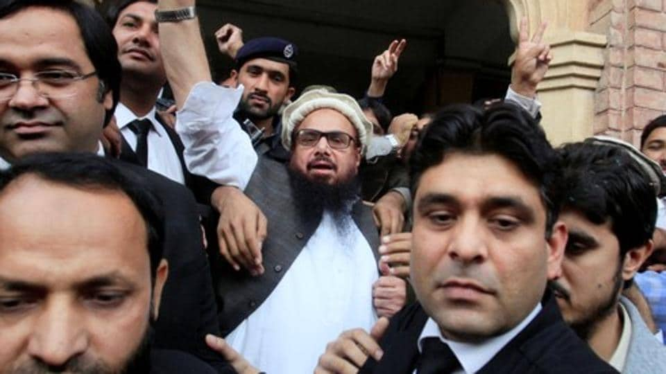 Hafiz Saeed (C) reacts to supporters as he walks out of court after a Pakistani court ordered his release from house arrest in Lahore, Pakistan November 22, 2017. REUTERS/Mohsin Raza
