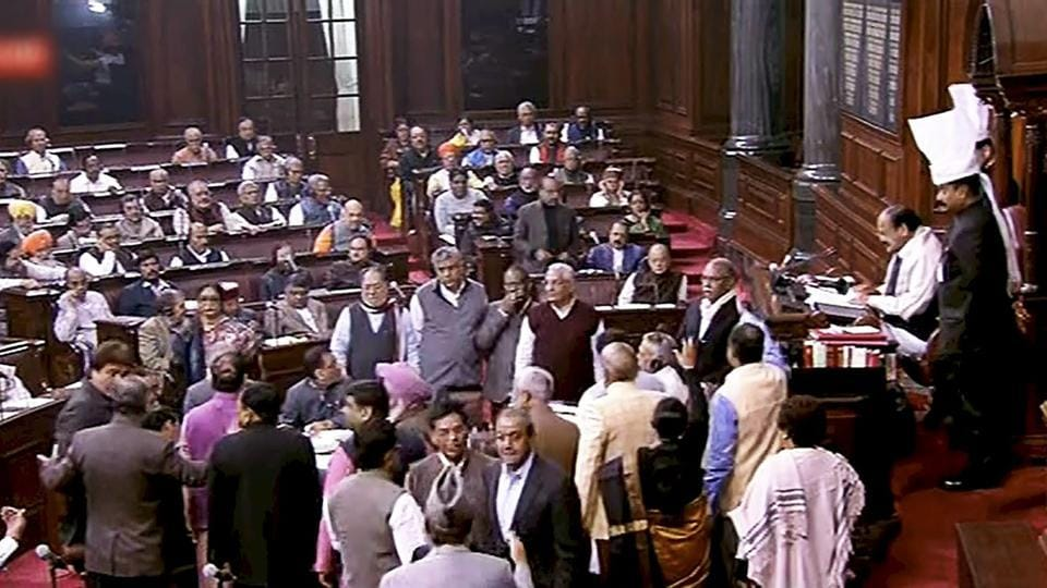 Opposition members protest inside the Rajya Sabha in New Delhi on Thursday during the ongoing winter session of Parliament.