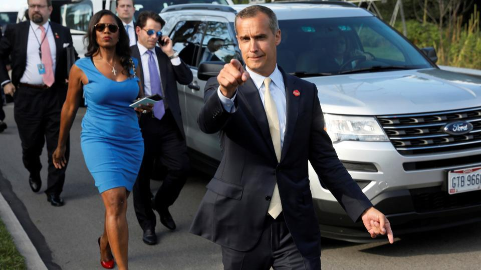 Former campaign manager Corey Lewandowski (C) says hello to reporters as he and White House advisors Sebastian Gorka (from L), Omarosa Manigault and Communications Director Anthony Scaramucci accompany President Trump for an event celebrating veterans at AMVETS Post 44 in Struthers, Ohio, U.S., July 25, 2017.
