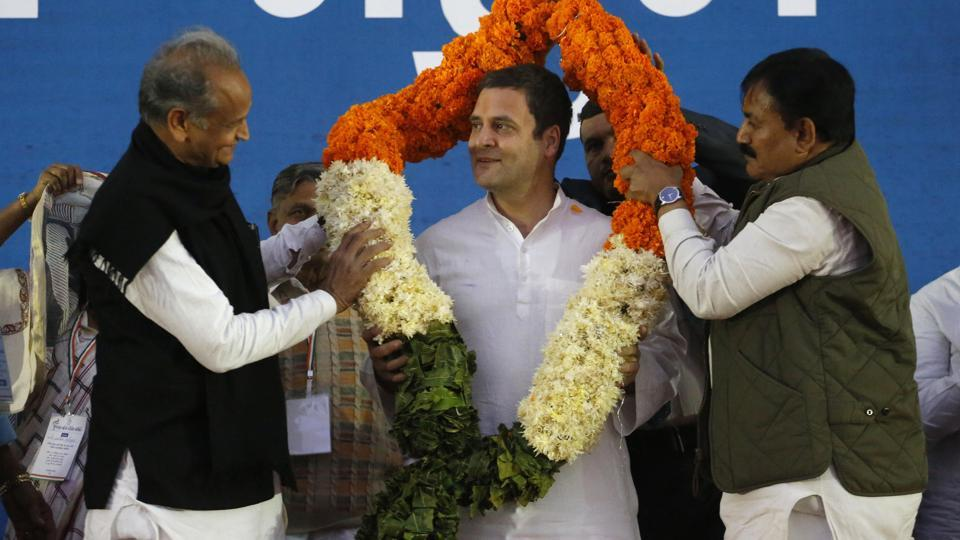 Congress president Rahul Gandhi, centre, is presented with a garland during a meeting in Ahmadabad on Saturday.