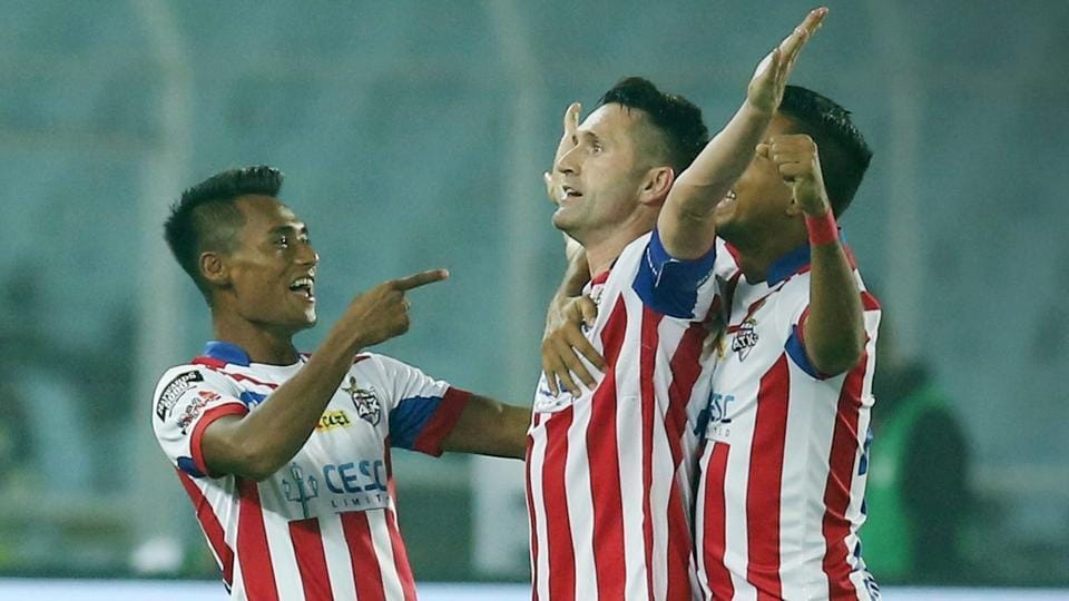 Robbie Keane (C) celebrates after scoring for ATK against Delhi Dynamos in their Indian Super League (ISL) encounter.