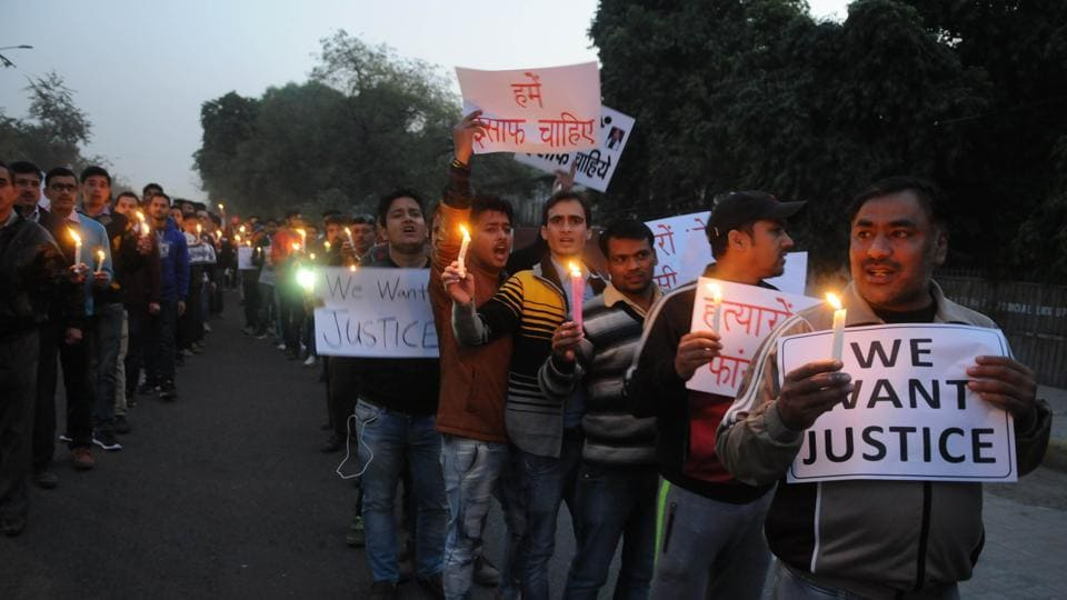 Family members and relatives of Sunil Bhatt hold candle light march in Gurgaon on Sunday.