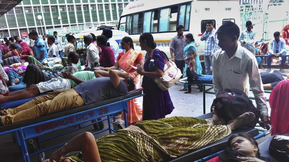 Patients wait in long queues outside AIIMS hospital's emergency wards, in September 2015.