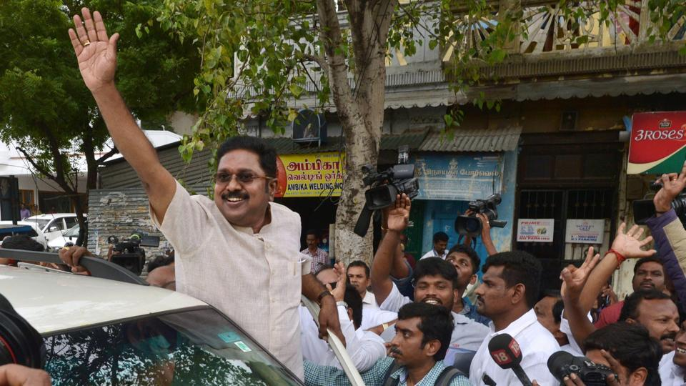 Sidelined AIADMK leader TTV Dhinakaran is seen waving  to his supporters on his way to file  nomination for the RK Nagar bypoll.