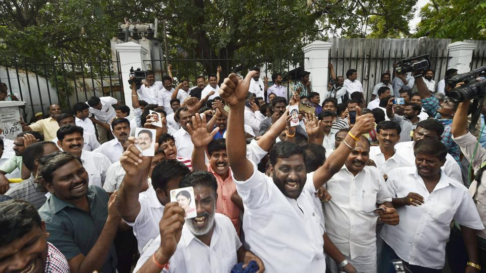 Supporters of sidelined AIADMK leader TTV Dhinakaran celebrate in Chennai after he won the RK Nagar bypoll.