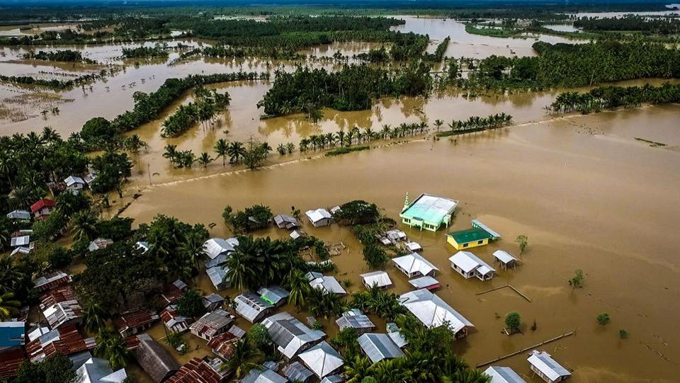An aerial view of the flooded municipality of Kabacan, on the southern island of Mindanao, Philippines. At least 230 people have been killed and scores still missing after a tropical storm triggered flash floods and landslides, wrecking Christmas for thousands now taking refuge in shelters. Tropical Storm Tembin lashed Mindanao island, home to 20 million people, on Friday prompting a massive rescue operation. (Ferdinandh Cabrera / AFP)