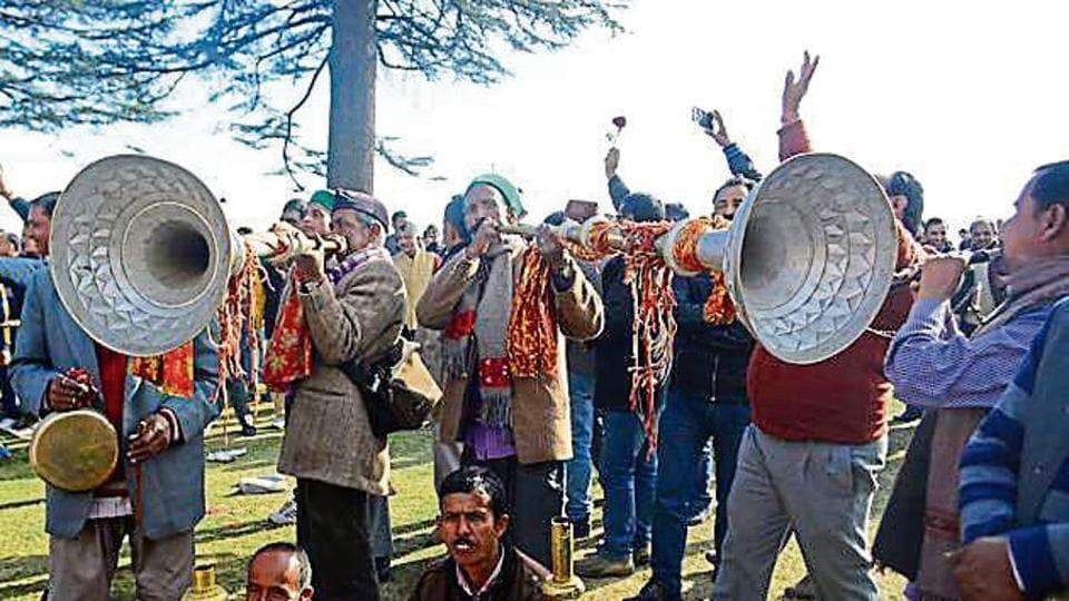 Jai Ram Thakur's supporters celebrating in Shimla on Sunday.