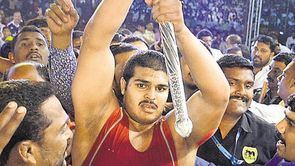 Abhijit Katke lifts the Silver Mace after winning his maiden Maharashtra Kesari title. (HTPHOTO)