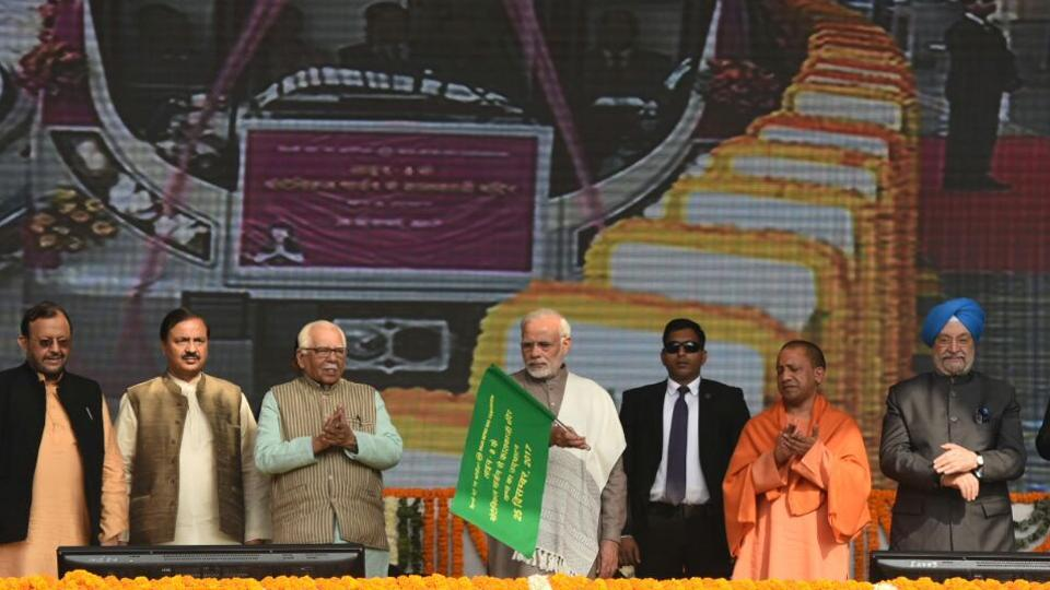 Prime Minister Narendra Modi flags off the Botanical Garden to Kalkaji Mandir stretch of the Delhi Metro's Magenta Line along with Uttar Pradesh chief minister Yogi Adityanath at Amity University Grounds in Noida, Uttar Pradesh on December 25, 2017. The 12.64-kilometre section of Delhi Metro's magenta line inaugurated today connects Noida to southeast delhi with seven other stations along the way. (Virendra Singh Gosain / HTPhoto)