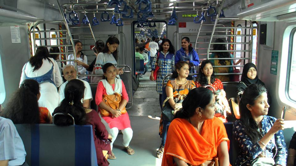 Commuters travel in an air-conditioned local train from Borivali to Churchgate in Mumbai, on Monday,.
