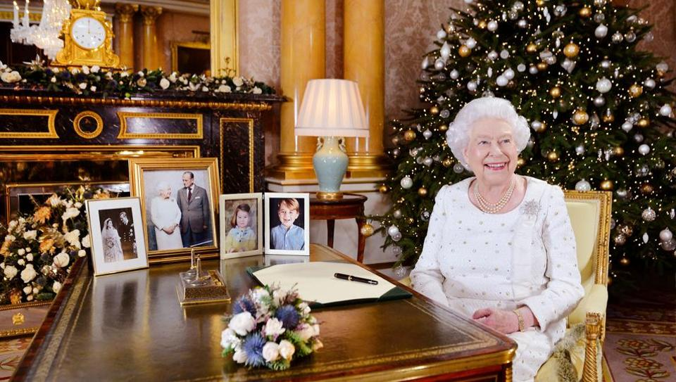 Britain's Queen Elizabeth is seen sitting at a desk in the 1844 Room after recording her Christmas Day broadcast to the Commonwealth, in Buckingham Palace, in this undated photograph received in London, Britain December 24, 2017.
