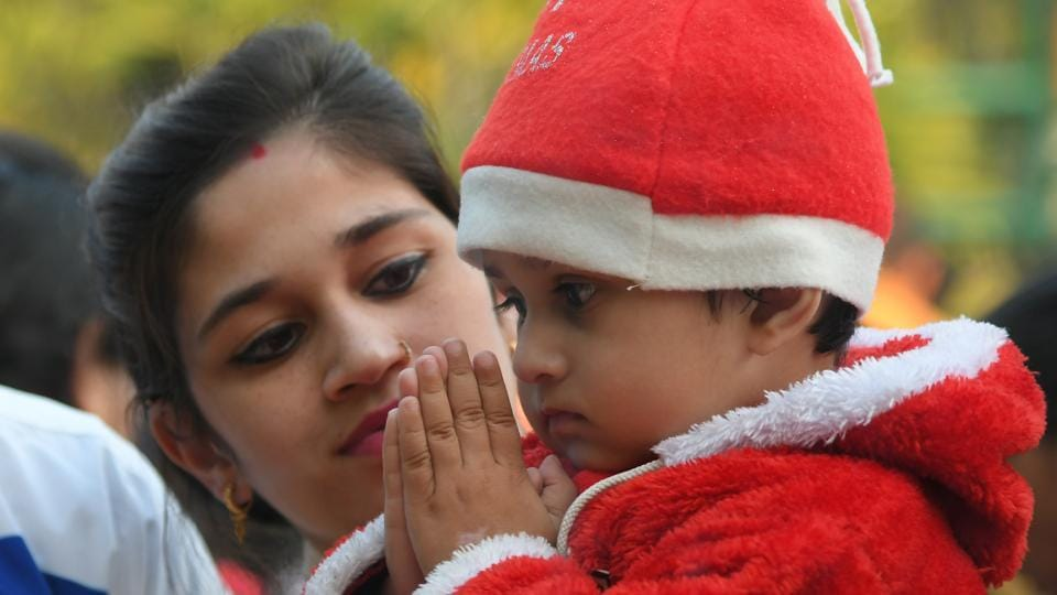 A child offers prayers at a church in Chandigarh on the eve of Christmas celebrations. (Karun Sharma/HT)