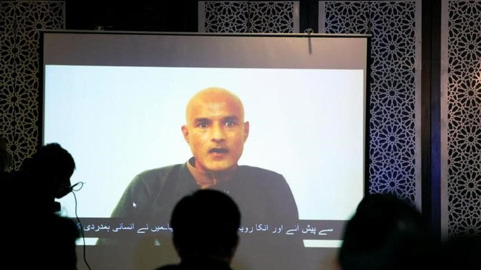 Former Indian navy officer Kulbhushan Sudhir Jadhav is seen on a screen during a news conference at the ministry of foreign affairs in Islamabad, Pakistan, on Monday.