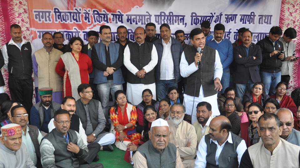 Congress members stage a protest outside Gandhi Park in Dehradun on Monday against the BJP government's