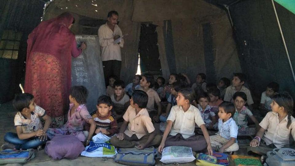 A school running in tent at the flood-affected Dhorimanna block in Barmer district.