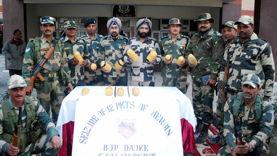 Border Security Force (BSF)  personnel showing  the 13kg seized heroin on the Indo-Pak border in Amritsar.