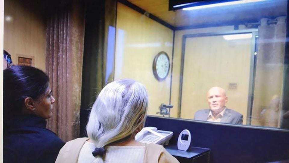 Former Indian Navy officer Kulbhushan Jadhav's wife and mother meet him while seated across a glass partition at the Pakistan foreign office in Islamabad on Monday.