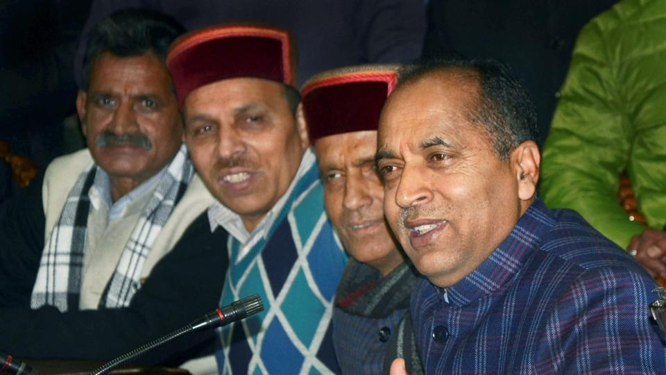 Himachal Pradesh chief minister designate Jai Ram Thakur (R) addresses a press conference in Shimla on Monday.