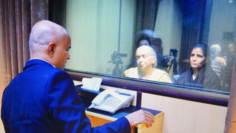 In this handout photo released by Pakistan foreign minister, the wife, right, and mother, centre, of imprisoned Indian naval officer Kulbhushan Jadhav, meet with Jadhav, left, at the foreign ministry in Islamabad.