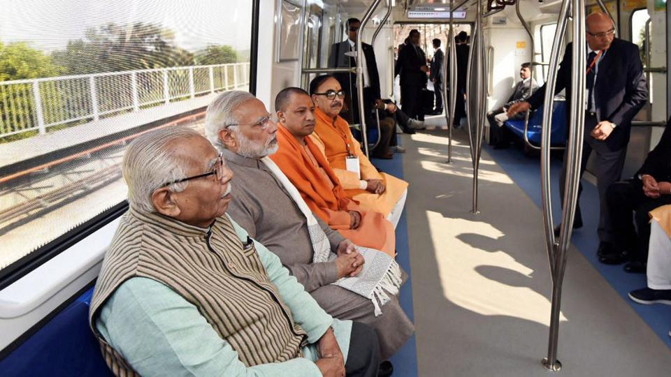 Prime Minister Narendra Modi rides the newly inaugurated magenta metro line from Botanical Garden station to Okhla Bird Sanctuary along with the Uttar Pradesh governor Ram Naik and state chief minister Yogi Adityanath at Noida on Monday.