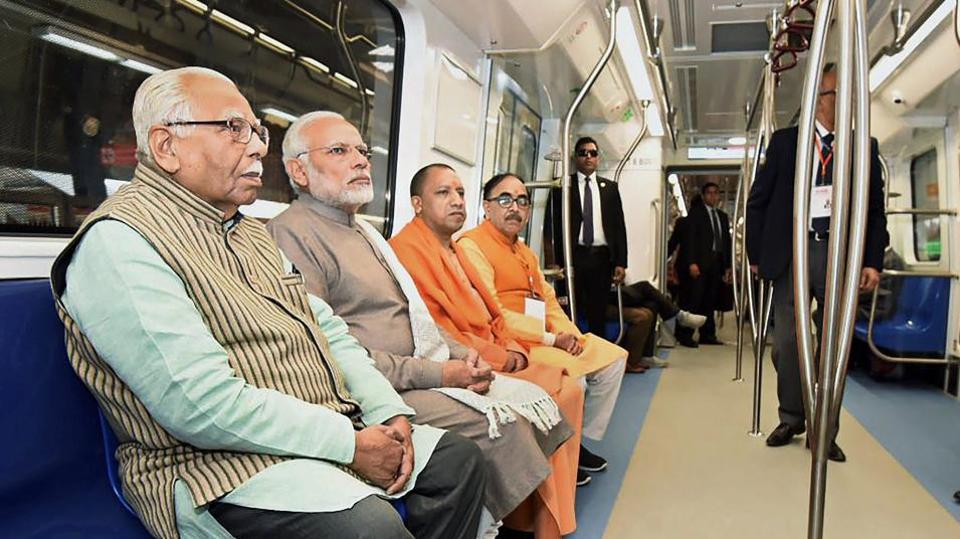 Prime Minister Narendra Modi takes a ride on a Metro train from Botanical Garden Station to Okhla Bird Sanctuary along with Uttar Pradesh governor Ram Naik and Uttar Pradesh CM Yogi Adityanath on Monday.