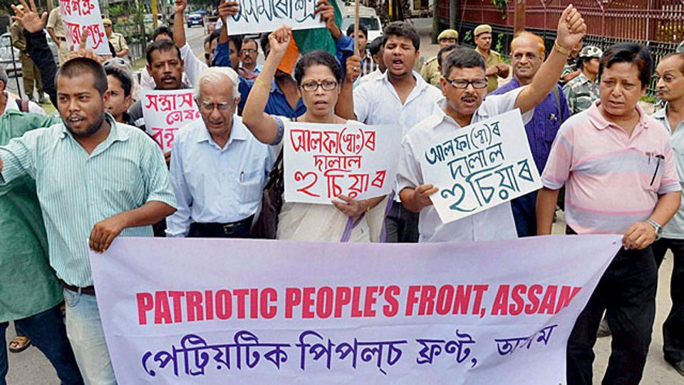 Activists in Guwahati walk with the banner of Patriotic People's Front of Assam, protesting against Ulfa militants who have targeted civilians in the state.